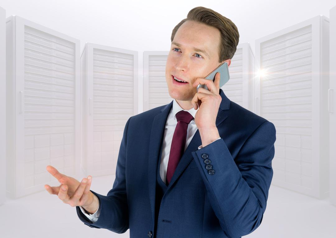 Businessman talking on mobile phone in the office Free Stock Images from PikWizard