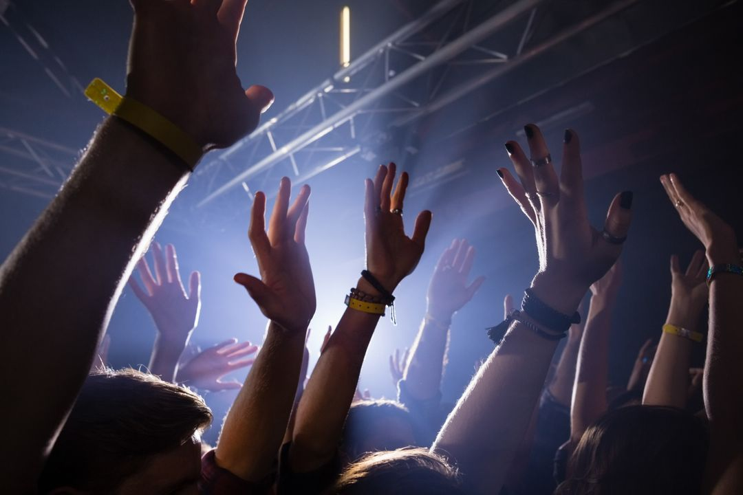 Hands up in the air at a concert