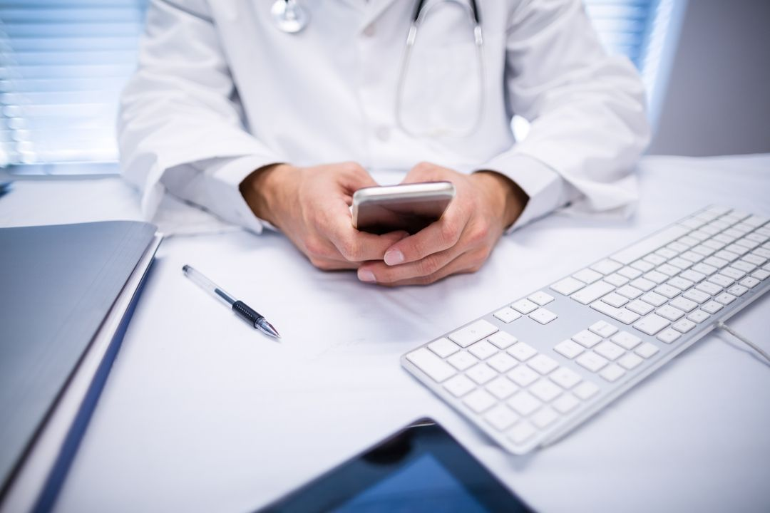 Mid section of doctor using mobile phone in clinic Free Stock Images from PikWizard