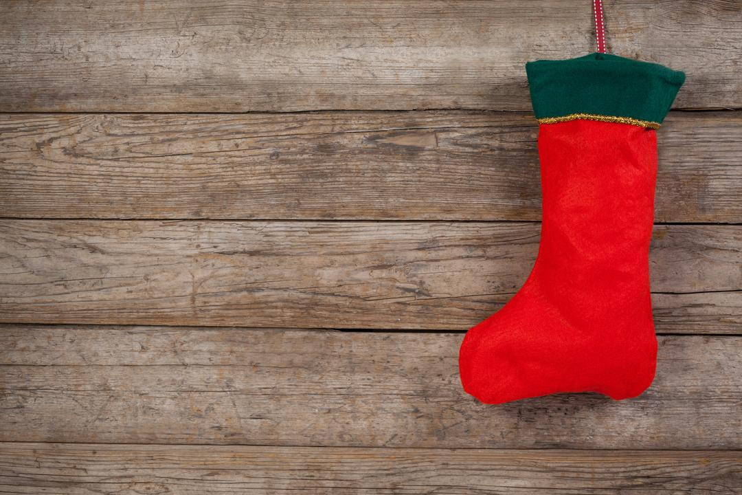 Christmas stocking on wooden wall during christmas time Free Stock Images from PikWizard