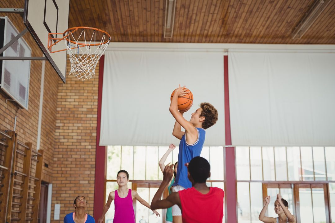 Determined high school kids playing basketball in the court Free Stock Images from PikWizard