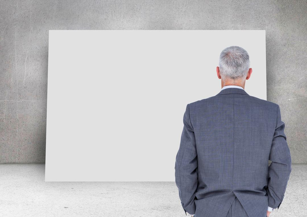 Digital composite of Businessman looking at blank card  with wall background