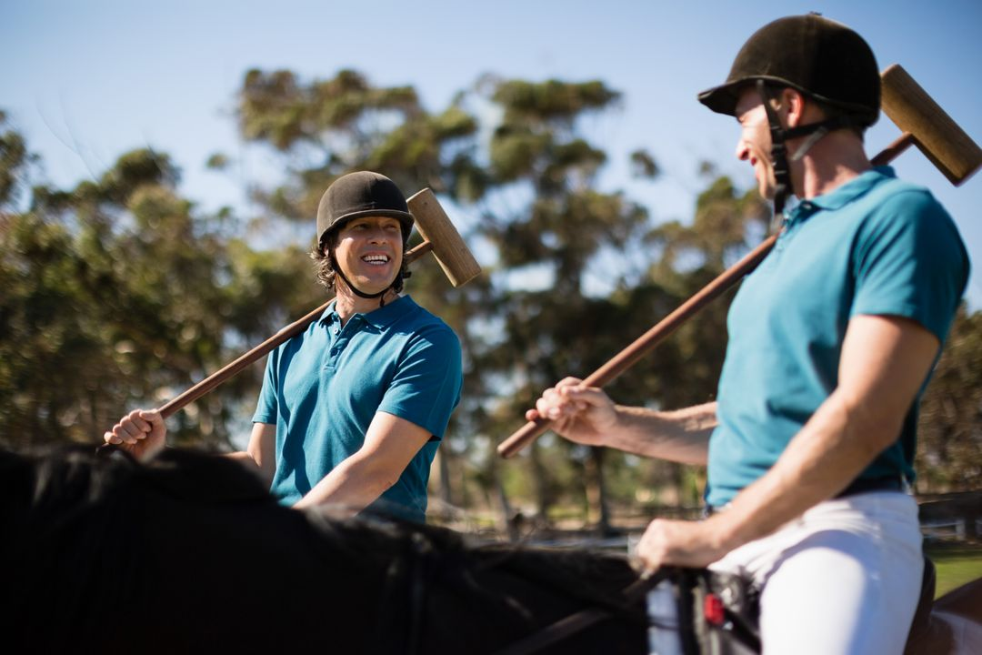 Two male jockeys riding horse in the ranch on a sunny day Free Stock Images from PikWizard
