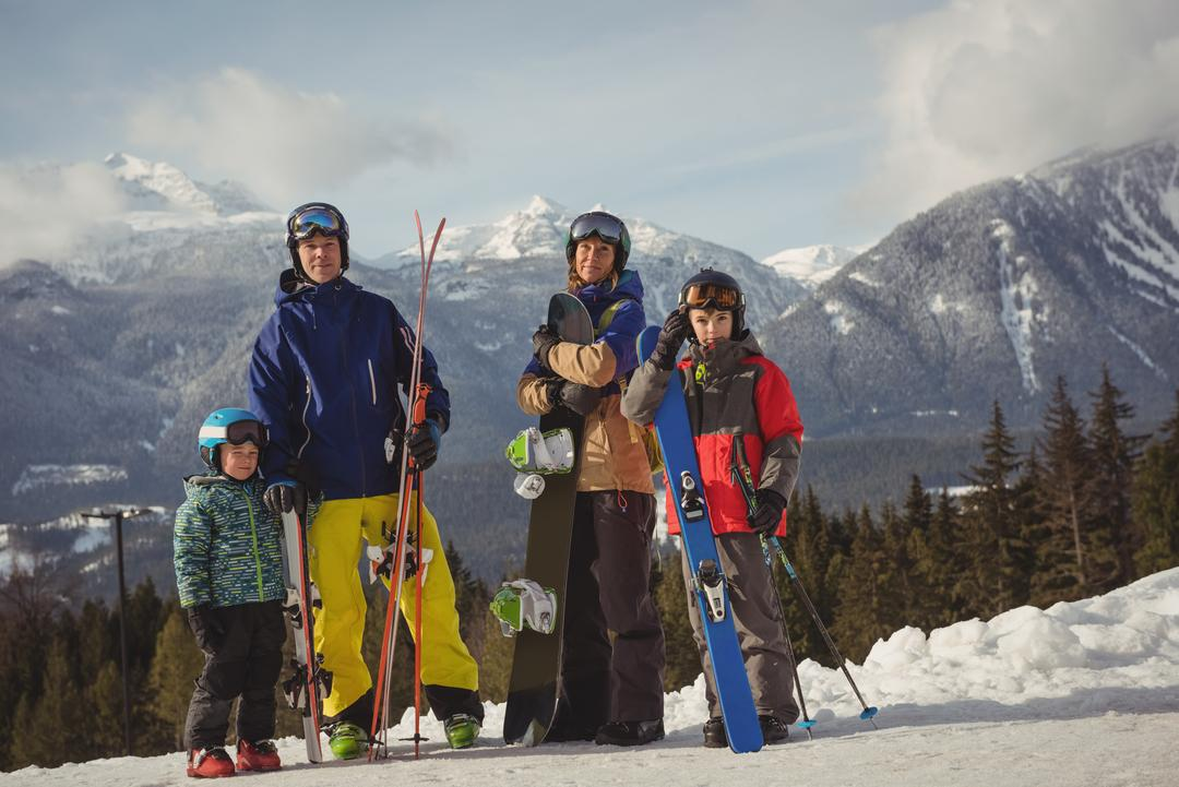 Family in skiwear standing together on snowy alps during winter Free Stock Images from PikWizard