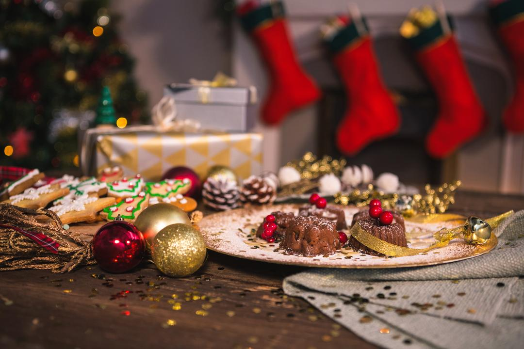Close-up of various christmas desserts on wooden table Free Stock Images from PikWizard