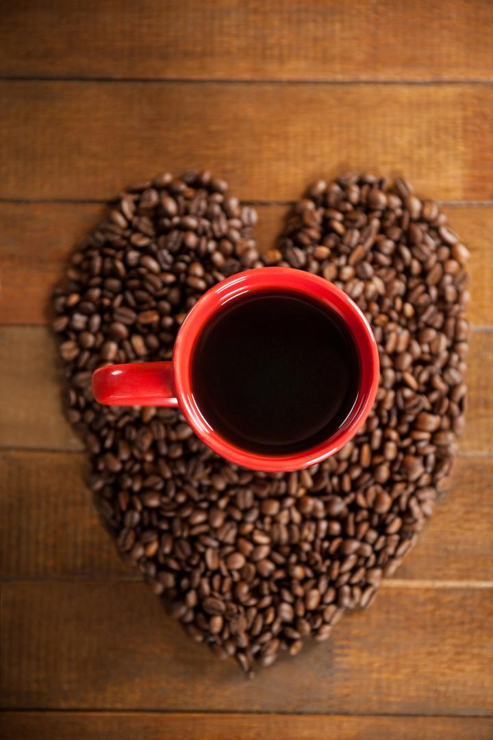 Coffee cup with heart shaped coffee beans