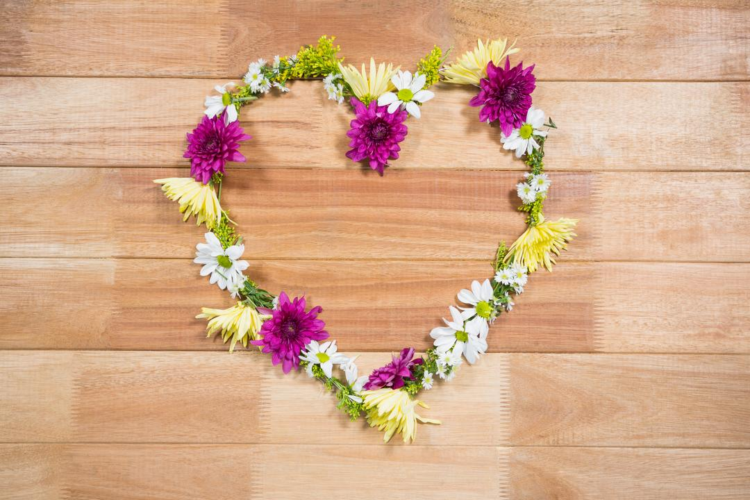 Tropical flower garland arranged in heart shape on wooden board Free Stock Images from PikWizard