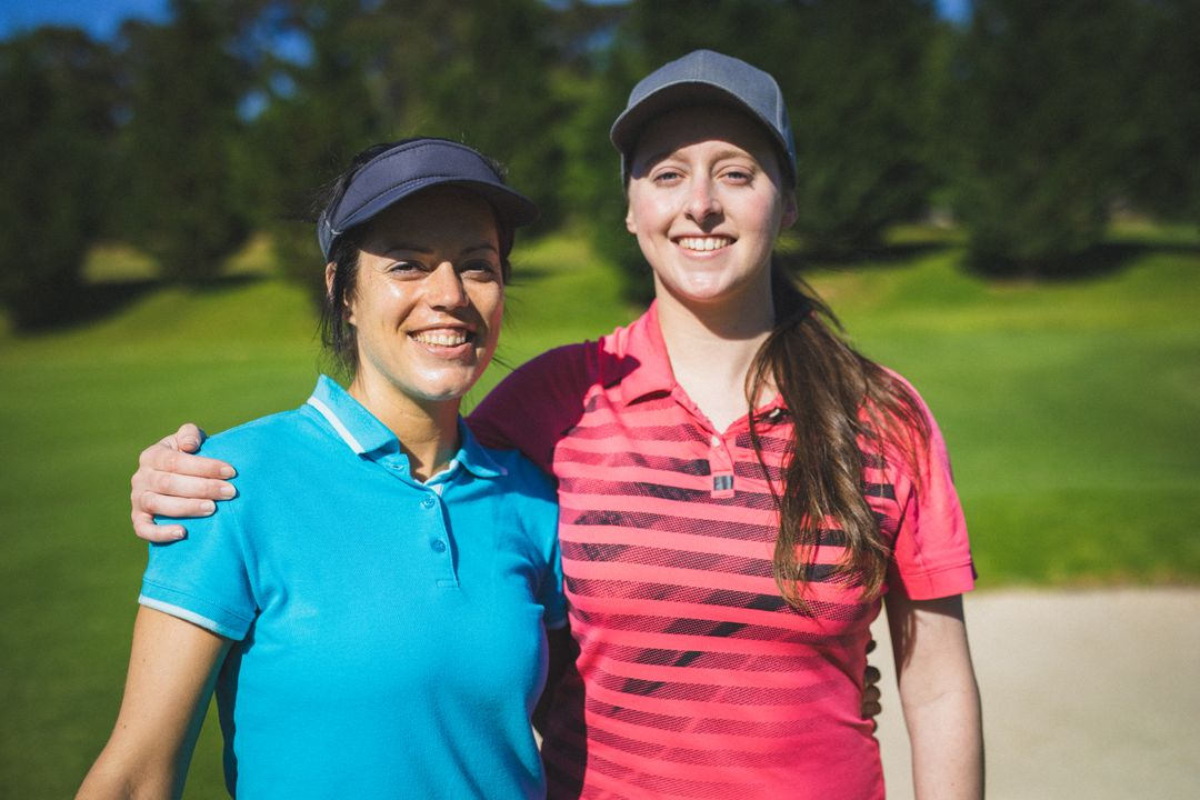 Portrait of two caucasian woman smiling while standing at golf course. Sports and active lifestyle concept. Free Stock Images from PikWizard