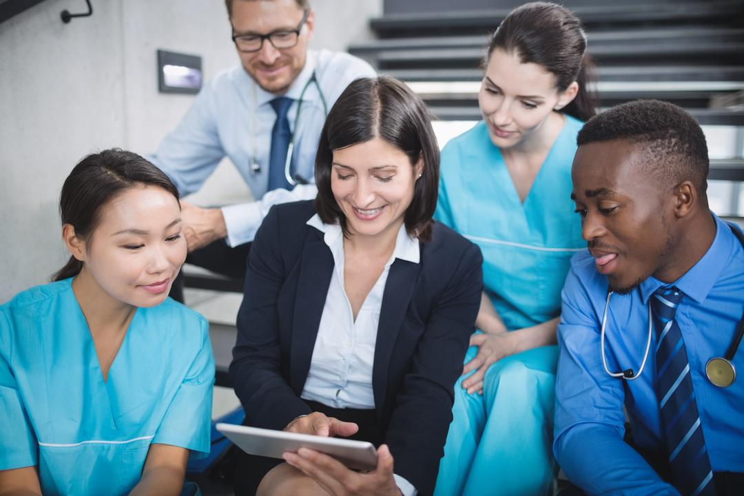 Doctors and nurse looking at digital tablet in hospital