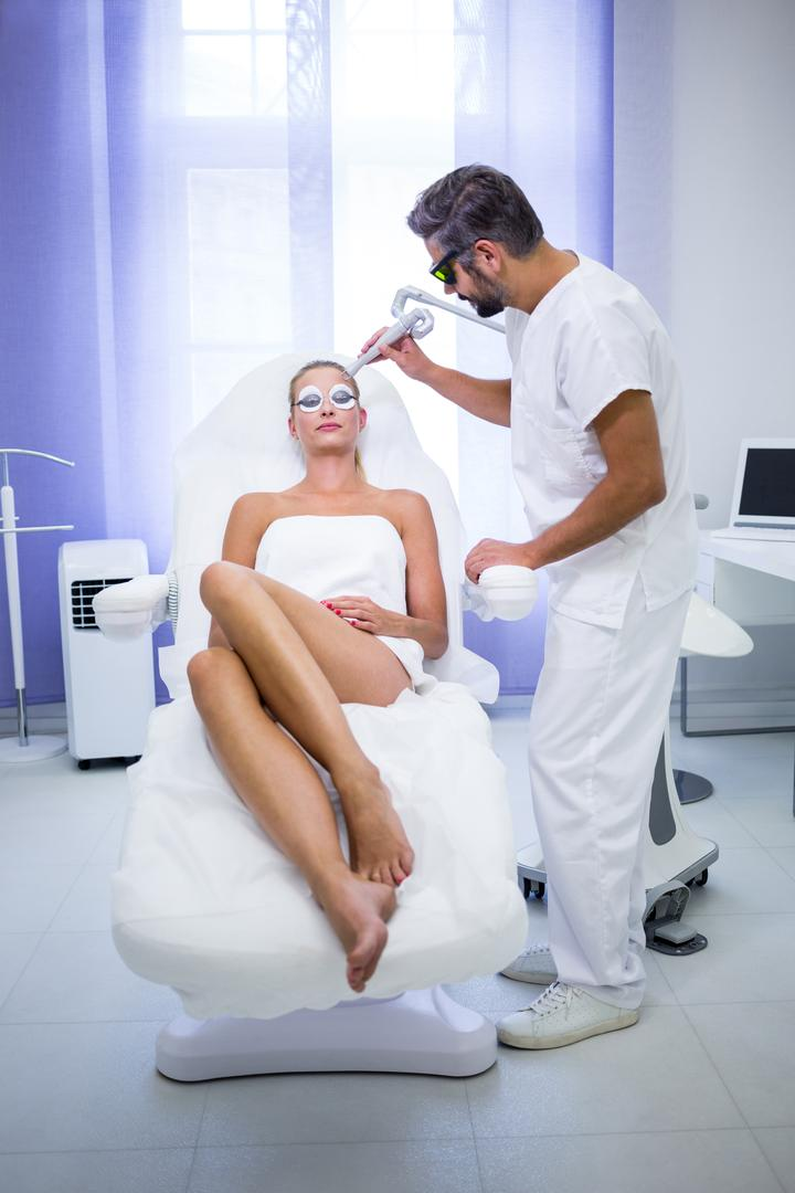 Female patient getting rf lifting procedure in a beauty saloon Free Stock Images from PikWizard
