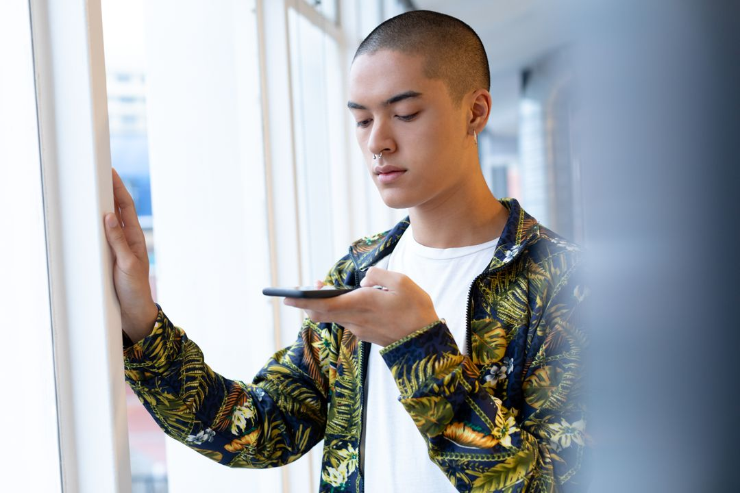 Young Businessman using mobile phone in the office