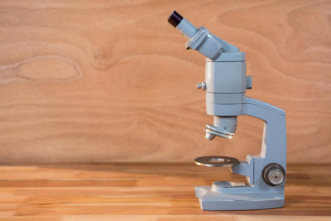Close-up of microscope on a wooden table Free Stock Images from PikWizard