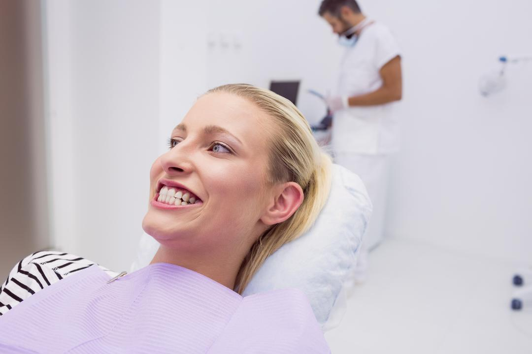 Woman showing her white teeth in clinic