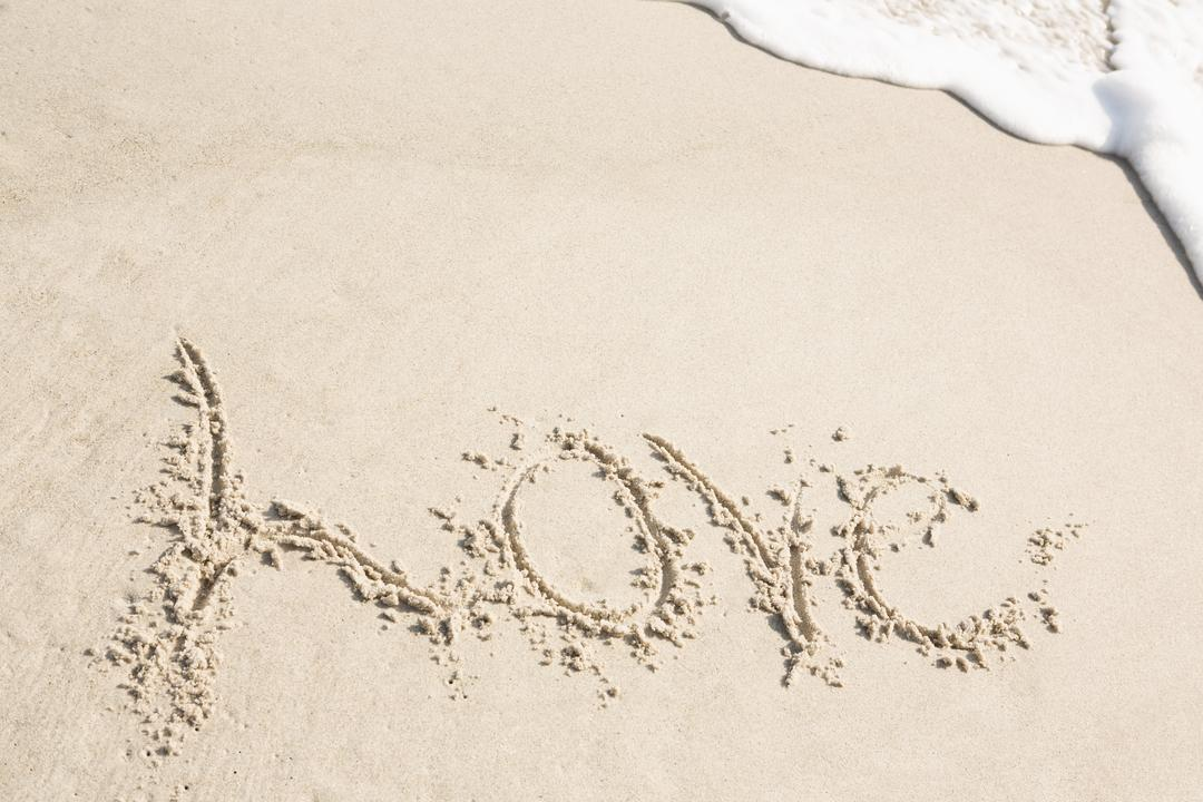 Love written on sand at beach Free Stock Images from PikWizard