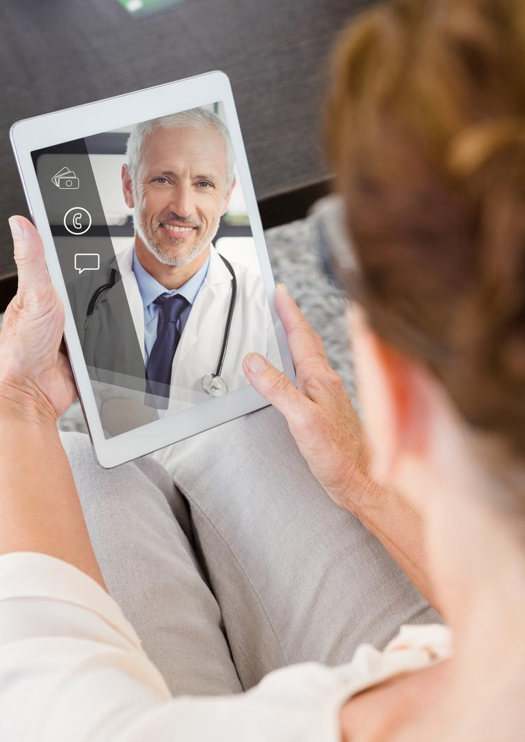 Close-up of senior woman having a video chat on digital tablet