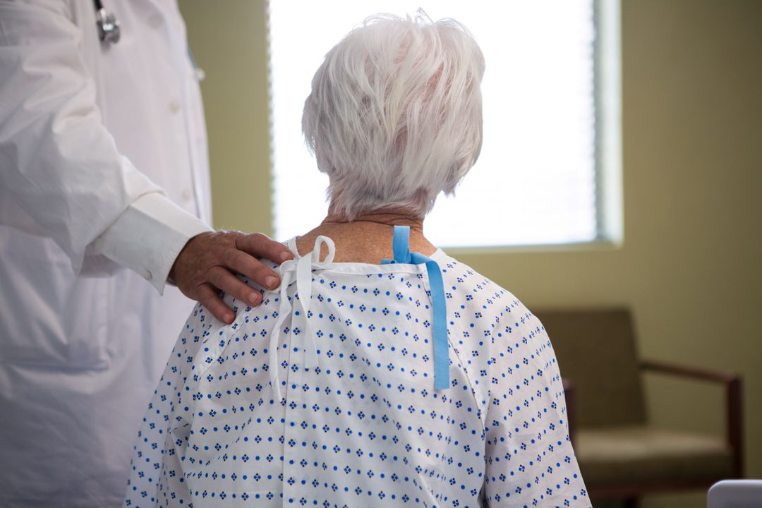 Doctor consoling senior patient in hospital Free Stock Images from PikWizard