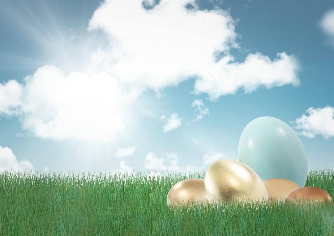 Digital composite of Blue easter egg with gold eggs on the grass