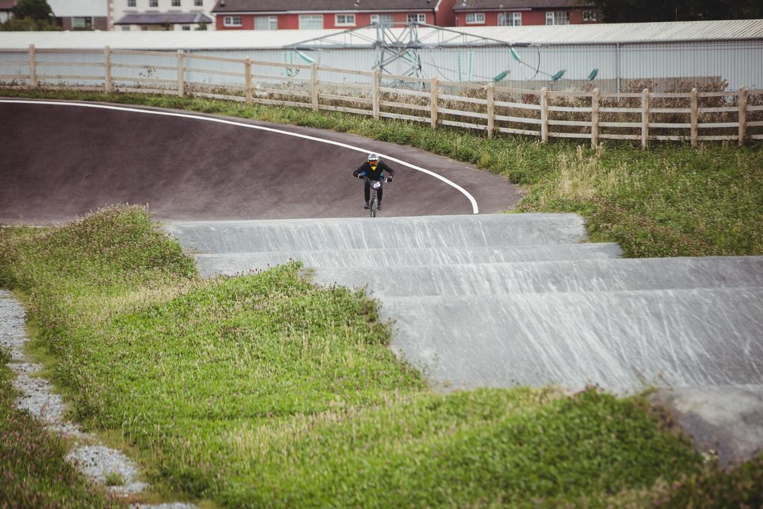 Cyclist riding BMX bike in skatepark Free Stock Images from PikWizard