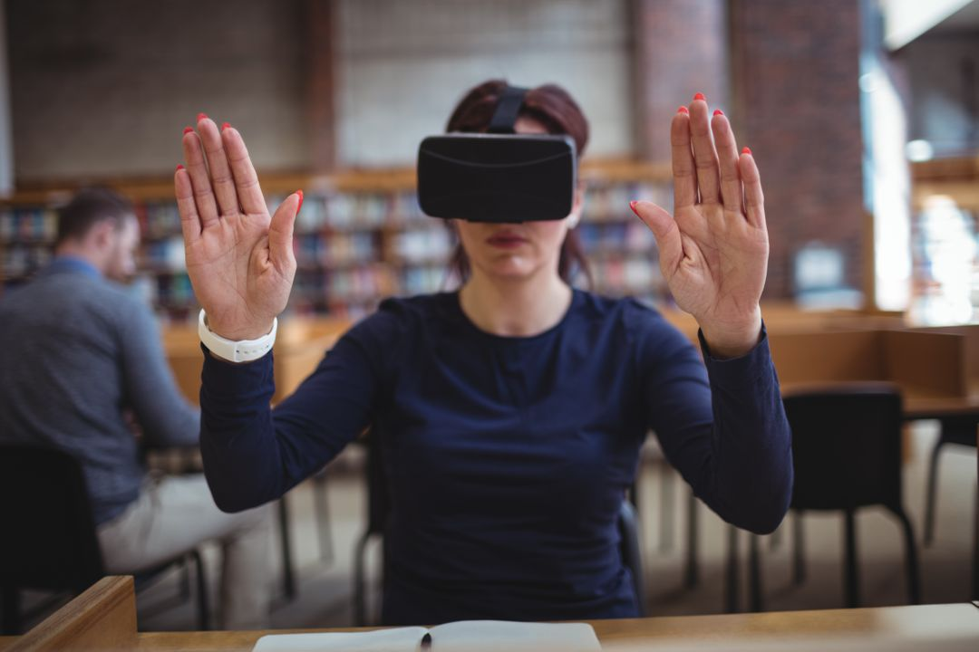 Mature student using virtual reality headset to help with studying in college library Free Stock Images from PikWizard