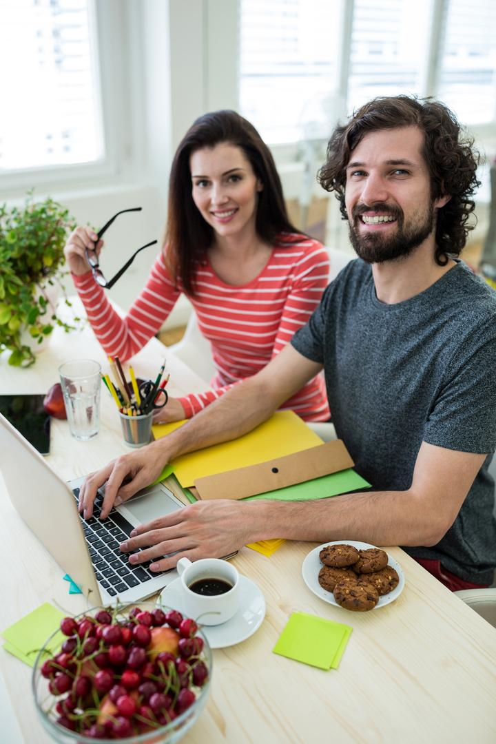 Male and female graphic designers using laptop in office Free Stock Images from PikWizard