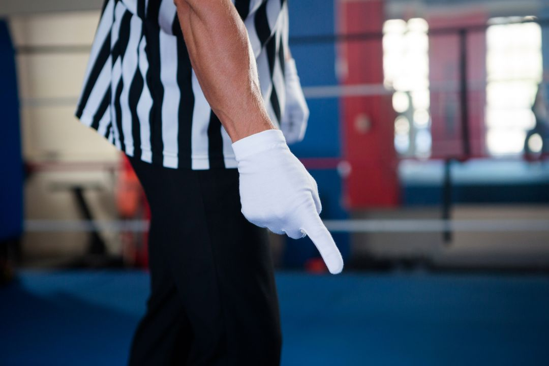 Midsection of male referee pointing down while standing in boxing ring Free Stock Images from PikWizard