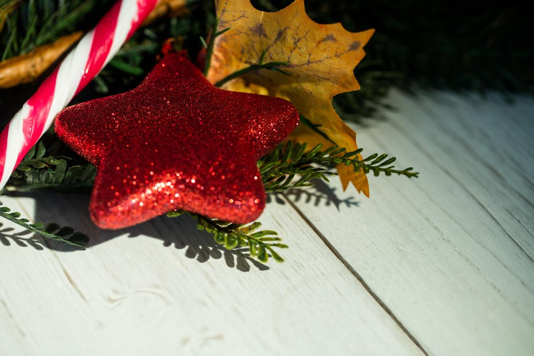 Close-up of christmas decorations on wooden plank during christmas time