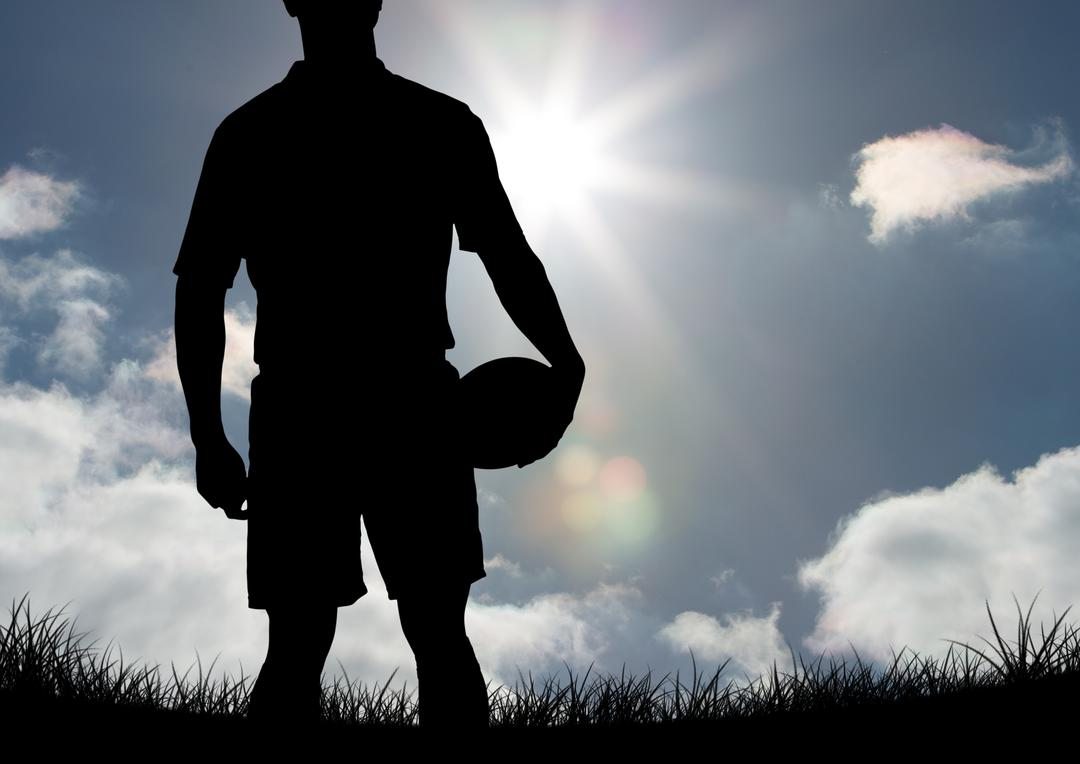 Digital composition of player silhouette holding a ball against sky in background