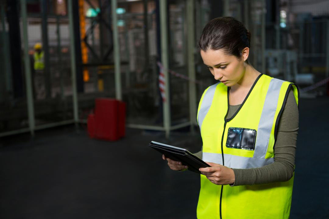Confident female worker using tablet pc in warehouse Free Stock Images from PikWizard