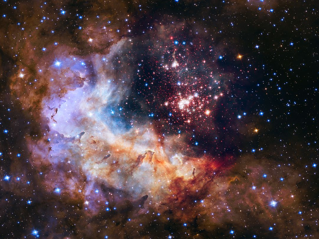 "The brilliant tapestry of young stars flaring to life resemble a glittering fireworks display in the 25th anniversary NASA Hubble Space Telescope image, released to commemorate a quarter century of exploring the solar system and beyond since its launch on April 24, 1990.  ""Hubble has completely transformed our view of the universe, revealing the true beauty and richness of the cosmos"" said John Grunsfeld, astronaut and associate administrator of NASA's Science Mission Directorate. ""This vista of starry fireworks and glowing gas is a fitting image for our celebration of 25 years of amazing Hubble science.""  The sparkling centerpiece of Hubble's anniversary fireworks is a giant cluster of about 3,000 stars called Westerlund 2, named for Swedish astronomer Bengt Westerlund who discovered the grouping in the 1960s. The cluster resides in a raucous stellar breeding ground known as Gum 29, located 20,000 light-years away from Earth in the constellation Carina.  Read more: <a href=""http://www.nasa.gov/press-release/nasa-unveils-celestial-fireworks-as-official-image-for-hubble-25th-anniversary"" rel=""nofollow"">www.nasa.gov/press-release/nasa-unveils-celestial-firewor...</a>  <b><a href=""http://www.nasa.gov/audience/formedia/features/MP_Photo_Guidelines.html"" rel=""nofollow"">NASA image use policy.</a></b>  <b><a href=""http://www.nasa.gov/centers/goddard/home/index.html"" rel=""nofollow"">NASA Goddard Space Flight Center</a></b> enables NASA's mission through four scientific endeavors: Earth Science, Heliophysics, Solar System Exploration, and Astrophysics. Goddard plays a leading role in NASA's accomplishments by contributing compelling scientific knowledge to advance the Agency's mission.  <b>Follow us on <a href=""http://twitter.com/NASAGoddardPix"" rel=""nofollow"">Twitter</a></b>  <b>Like us on <a href=""http://www.facebook.com/pages/Greenbelt-MD/NASA-Goddard/395013845897?ref=tsd"" rel=""nofollow"">Facebook</a></b>  <b>Find us on <a href=""http://instagrid.me/nasagoddard/?vm=grid"" rel=""nofollow"">Instagram</a></b>"