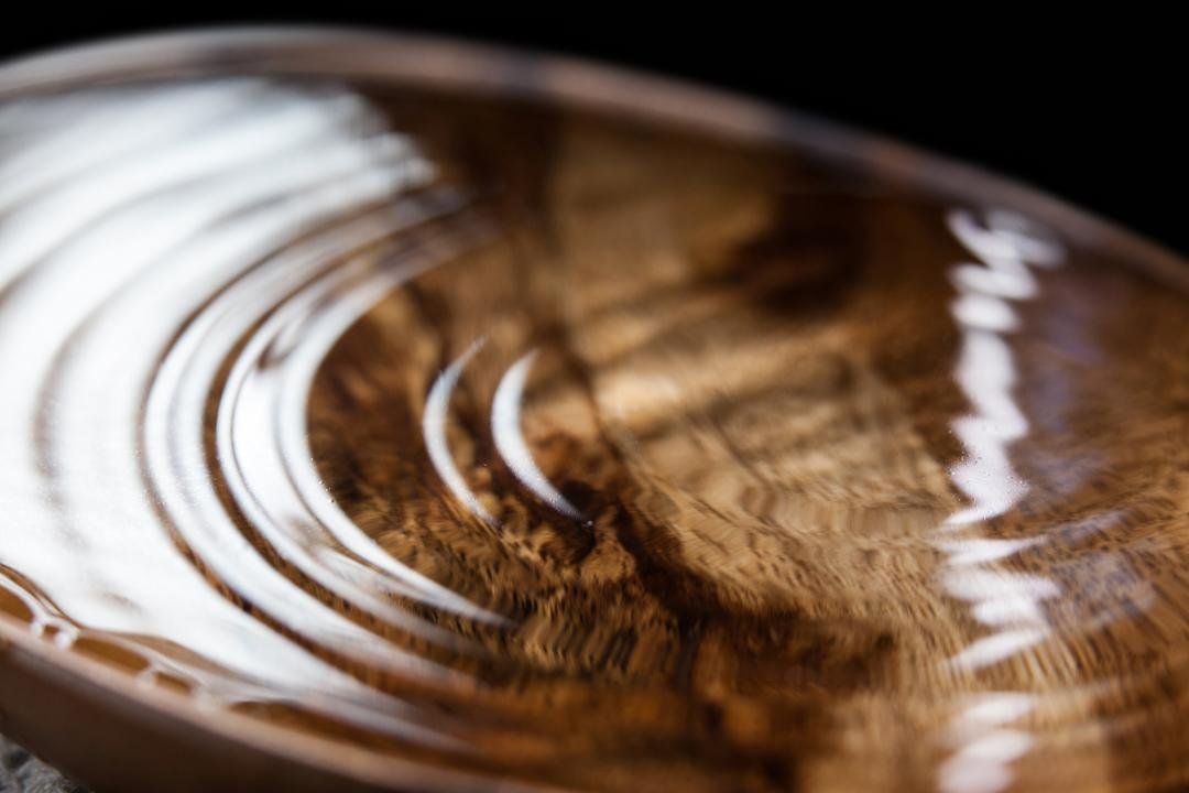 Close-up of wooden bowl of water