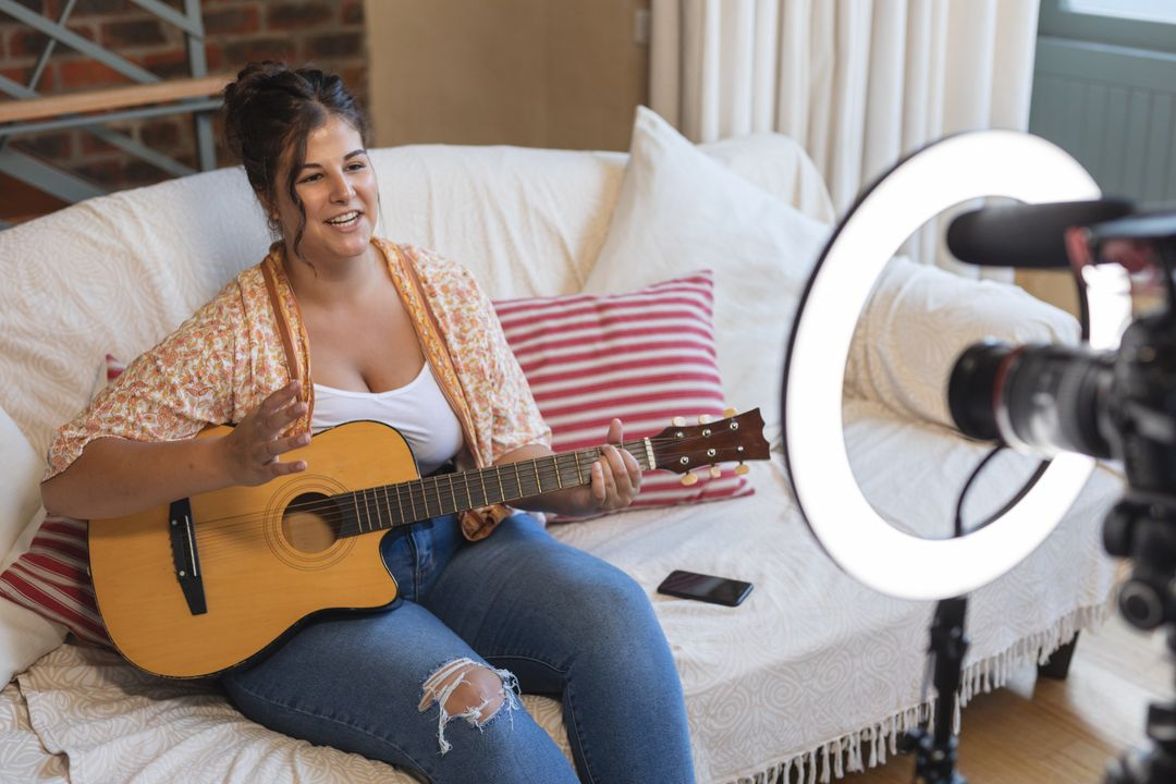 Youtuber palying guitar for YouTube video