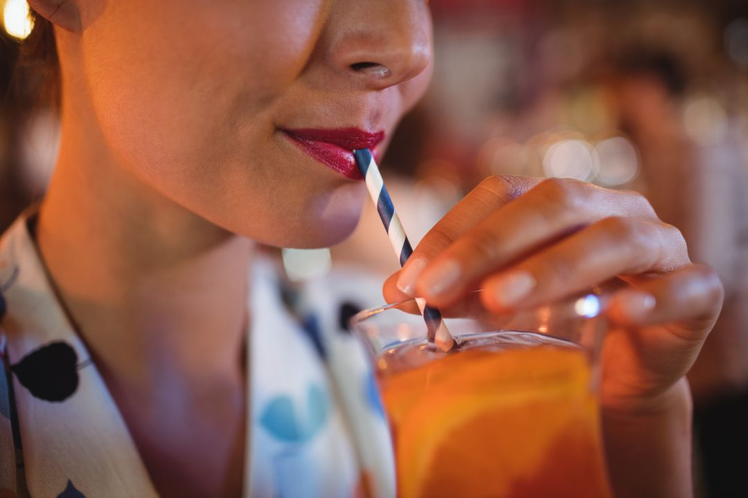 Close-up of woman having cocktail drink in pub Free Stock Images from PikWizard