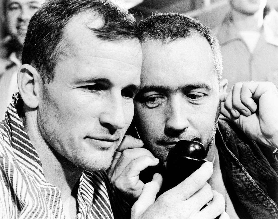 S65-33533 (7 June 1965) --- The Gemini-4 prime crew, astronauts Edward H. White II (left), pilot; and James A. McDivitt, command pilot, listen to the voice of President Lyndon B. Johnson as he congratulated them by telephone on their successful four-day, 62-revolution Gemini-4 mission. They are shown aboard the aircraft carrier USS Wasp just after their recovery from the Atlantic. Free Stock Images from PikWizard