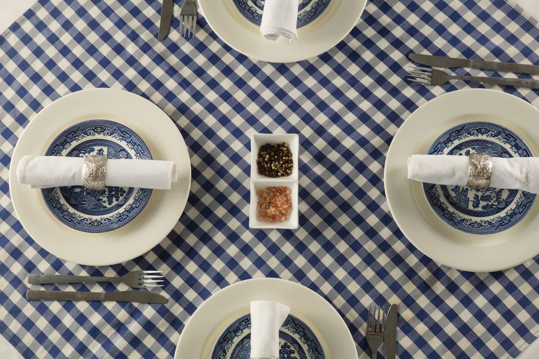 Overhead of rolled up napkin arranged on plate