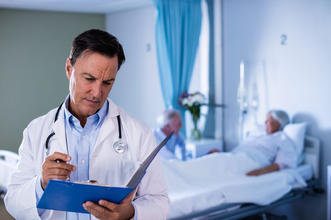 Male doctor looking at medical report in hospital