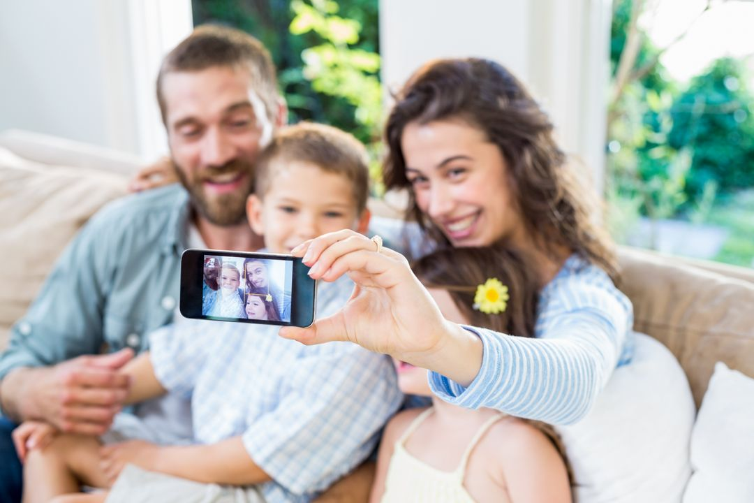 Happy family taking a selfie on mobile phone Free Stock Images from PikWizard