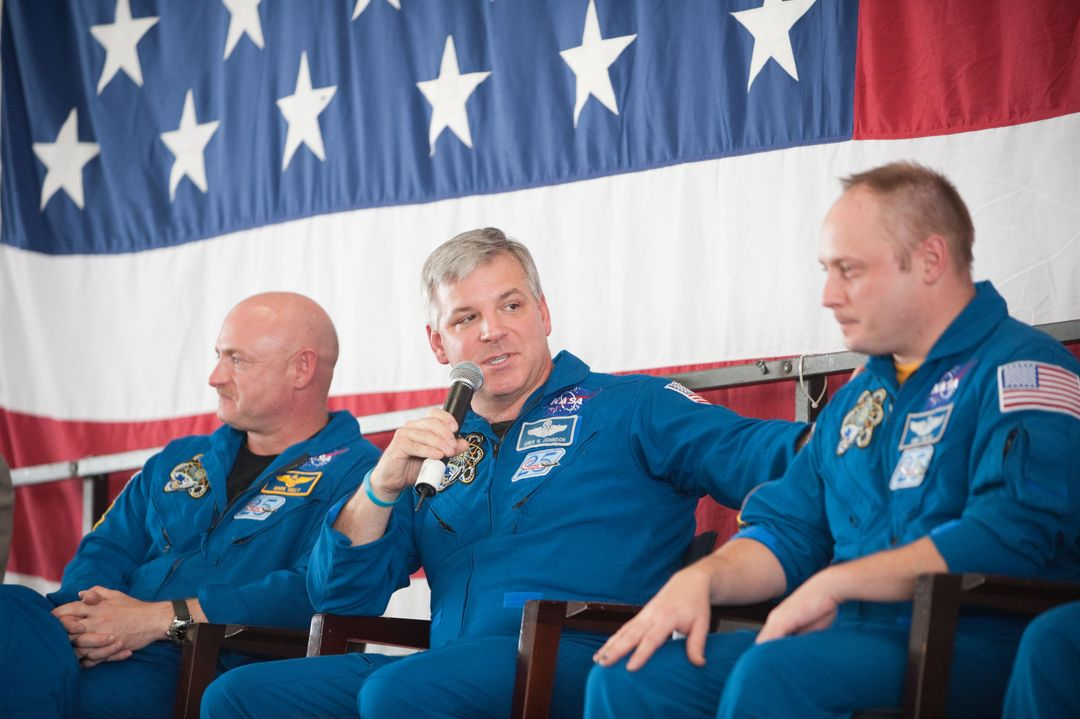 JSC2011-E-050705 (2 June 2011) --- NASA astronauts Mark Kelly (left), STS-134 commander; Greg H. Johnson, pilot; and Michael Fincke, mission specialist, are pictured during the STS-134 crew return ceremony on June 2, 2011 at Ellington Field near NASA's Johnson Space Center. Photo credit: NASA