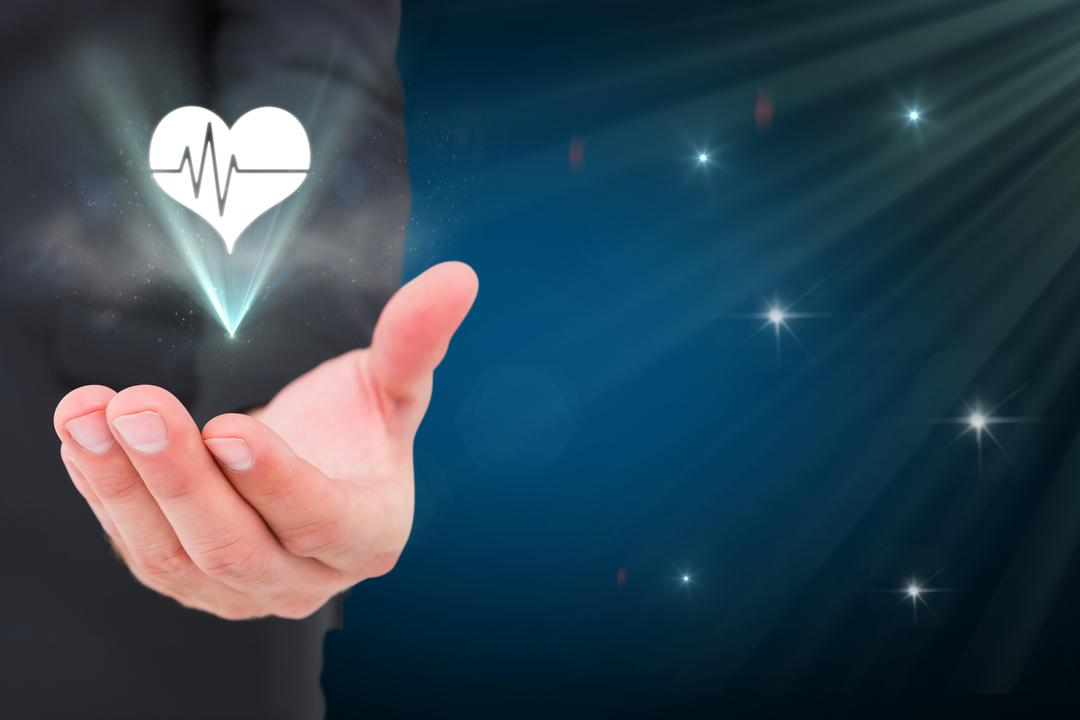 Composite of hand holding heart graphic with stars background