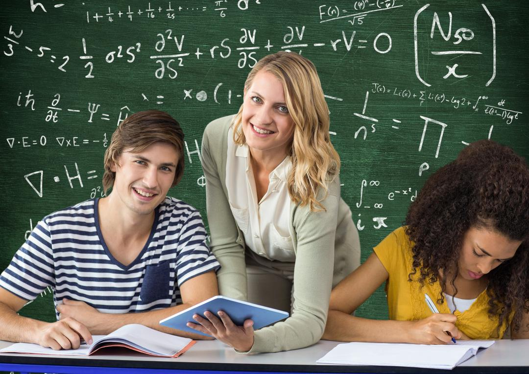 Smiling teacher teaching students against mathematical formulas on green board Free Stock Images from PikWizard