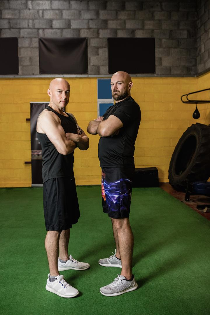 Portrait of confident thai boxers standing with arms crossed in the fitness studio Free Stock Images from PikWizard