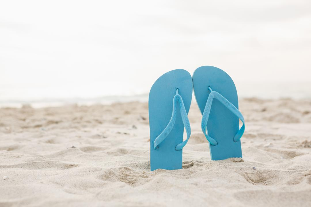 Blue flip flop in sand on beach Free Stock Images from PikWizard