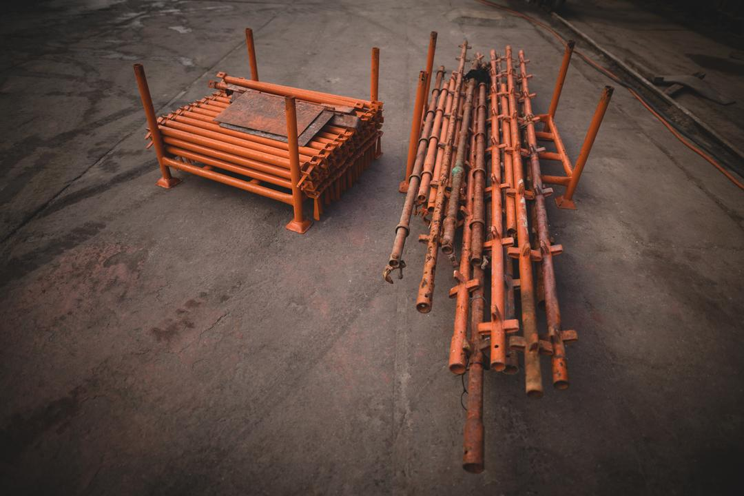 Overhead of iron rods and pallet kept on harbor