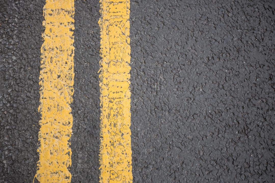 Yellow road marking on road surface, full frame Free Stock Images from PikWizard