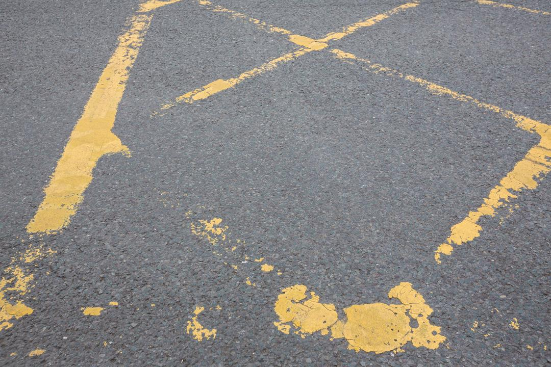 Close-up of road marking on road surface Free Stock Images from PikWizard