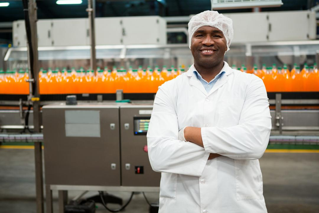 Portrait of confident male worker standing in juice factory