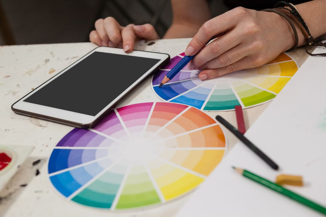 Woman creating color scheme with color wheel