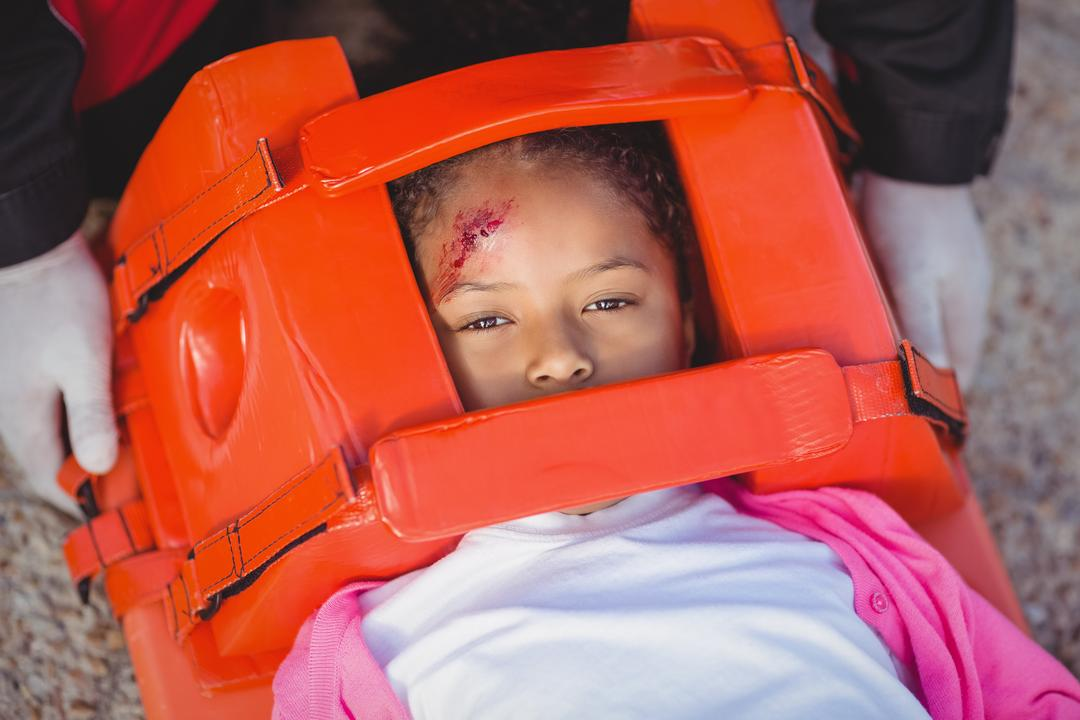 Injured girl treated by paramedic at accident spot