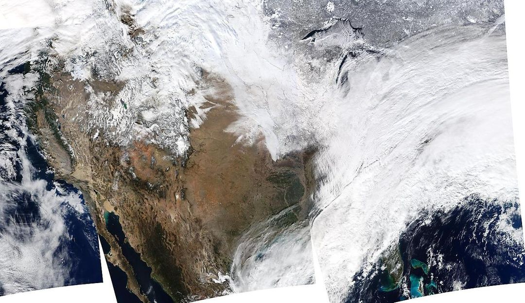 "On January 2, 2014, NASA's Aqua satellite passed over the United States mutiple times showing winter weather, allowing the Moderate Resolution Imaging Spectroradiometer (MODIS) on board to capture this true-color image of a massive winter storm moving up the eastern seaboard.  According to the National Weather Service the winter storm that impacted the Midwest and Northeast over the past couple of days is moving into the Atlantic Friday. Very cold temperatures and dangerous wind chills are moving in behind the system. The next storm is forming, and will bring blizzard conditions to the northern Plains Friday Night into Saturday. Extreme wind chills to -55 F are possible in the northern Plains this weekend.   Credit: NASA/GSFC/Aqua/MODIS  <b><a href=""http://www.nasa.gov/audience/formedia/features/MP_Photo_Guidelines.html"" rel=""nofollow"">NASA image use policy.</a></b>  <b><a href=""http://www.nasa.gov/centers/goddard/home/index.html"" rel=""nofollow"">NASA Goddard Space Flight Center</a></b> enables NASA's mission through four scientific endeavors: Earth Science, Heliophysics, Solar System Exploration, and Astrophysics. Goddard plays a leading role in NASA's accomplishments by contributing compelling scientific knowledge to advance the Agency's mission.  <b>Follow us on <a href=""http://twitter.com/NASA_GoddardPix"" rel=""nofollow"">Twitter</a></b>  <b>Like us on <a href=""http://www.facebook.com/pages/Greenbelt-MD/NASA-Goddard/395013845897?ref=tsd"" rel=""nofollow"">Facebook</a></b>  <b>Find us on <a href=""http://instagrid.me/nasagoddard/?vm=grid"" rel=""nofollow"">Instagram</a></b>"