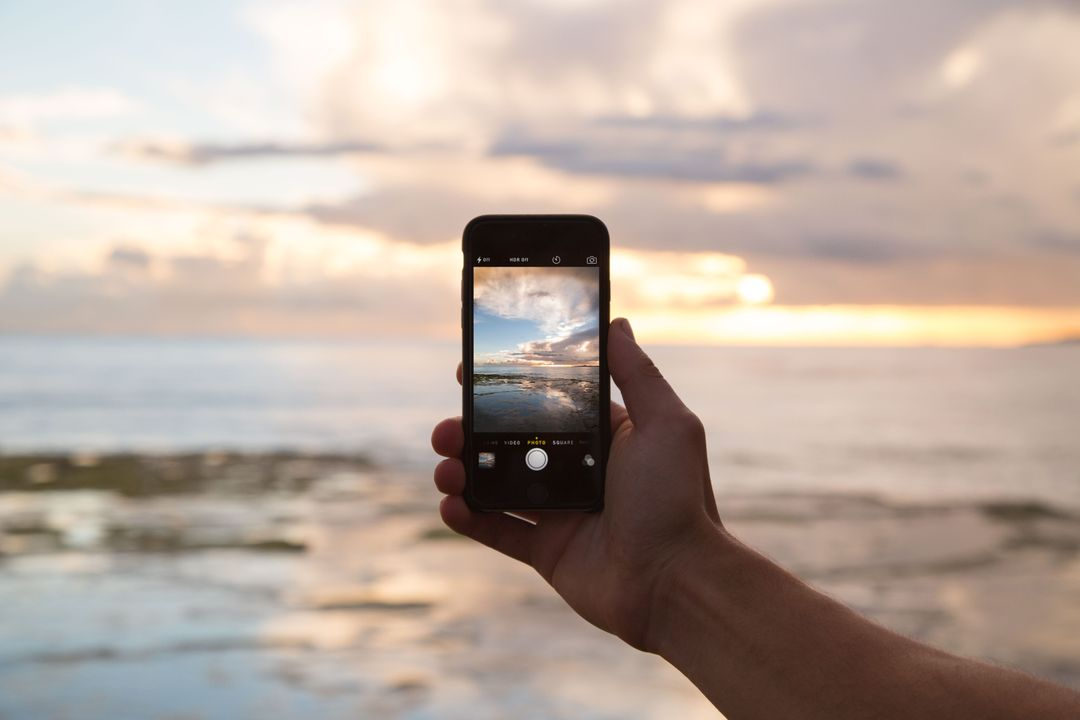 A phone taking a picture of the sea