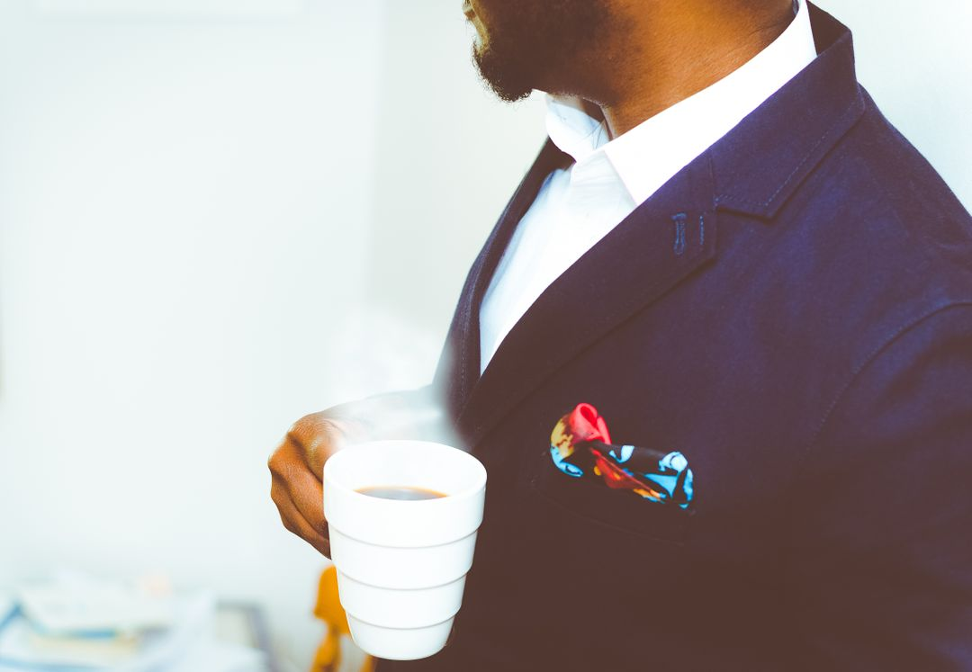 Image 7 How To Start A Fashion Blog - Man with blue suit and a cup of coffee.